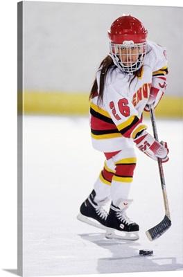 Young girl playing ice hockey