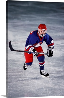 Young ice hockey player in action