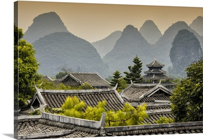 Chinese Buddhist Temple with Karst Mountains at Sunset