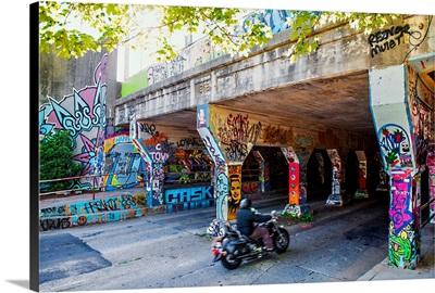 A motorcyclist enters the graffiti-covered Krog Street Tunnel in Atlanta, Georgia