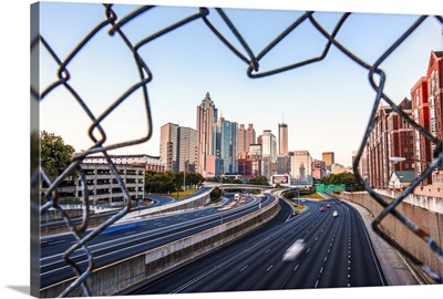 Atlanta, Georgia skyline framed by a chain link fence