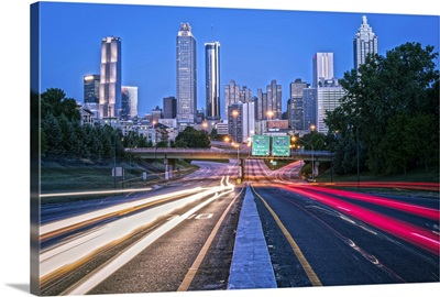 Light trails from traffic with the Atlanta, Georgia skyline at dusk