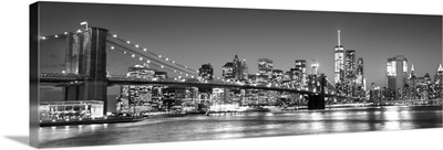 New York City Skyline with Brooklyn Bridge in Foreground, at Night