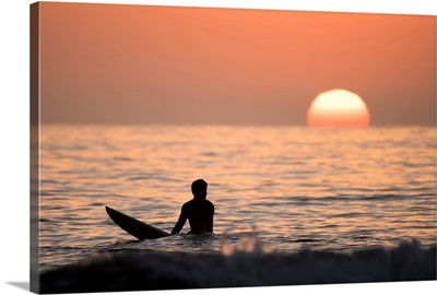 Silhouetted Surfer at Sunset, San Diego Coast, California