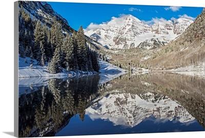 Snowy Maroon Bells mirrored in Maroon Lake below, Aspen, Colorado