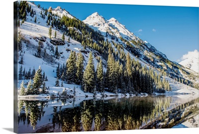 Snowy mountainside surrounding Maroon Lake in the Maroon Bells, Aspen, Colorado