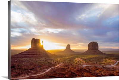 Sunrise At The Mittens And Merrick Buttes In Monument Valley, Arizona