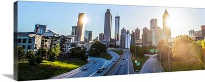 The sun shining just behind a skyscraper in the Atlanta, Georgia skyline
