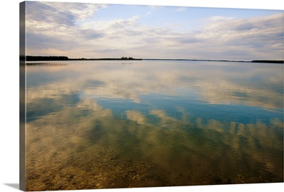 Clouds reflected on the smooth waters of Iskwasum Lake
