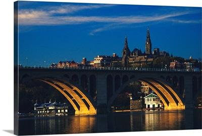 Dusk view of Georgetown U. above Key Bridge over the Potomac River
