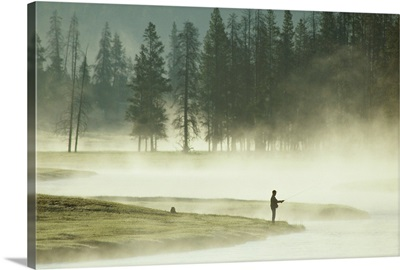 Fishermen in the morning mist on the Madison River, Yellowstone National Park, Wyoming