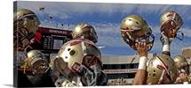 FSU Picture Football Helmets Held High