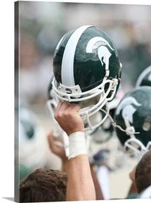 Spartain Helmet Held High