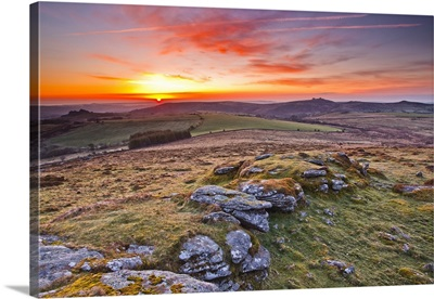 A colourful dawn on Chinkwell Tor in Dartmoor National Park, Devon, England