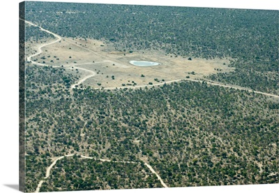 Aerial view of airstrip, road and small waterhole, Etosha National Park, Namibia, Africa
