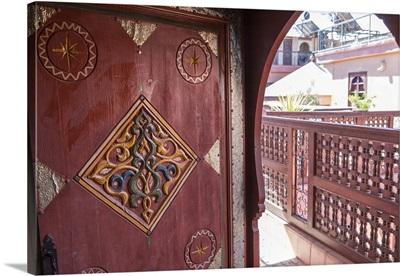 An ornate doorway in Riad Amsaffah, Marrakech, Morocco, Africa