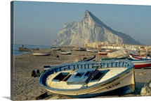 Boats pulled onto beach below the Rock of Gibraltar, Gibraltar