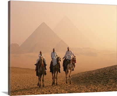 Camel riders at Giza Pyramids, Giza, Cairo, Egypt, Africa
