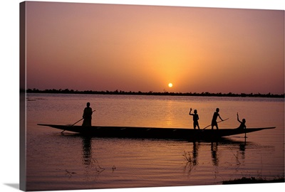 Children on local pirogue or canoe on the Bani River at sunset at Sofara, Mali, Africa