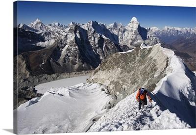 Climber on summit ridge of Island Peak, Ama Dablam, Himalayas, Nepal
