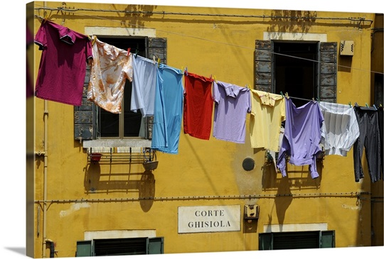 Clothes hanging on a washing line between houses, Venice, Veneto ...