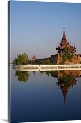Corner of the surrounding wall reflected in the moat, Mandalay Palace, Mandalay, Myanmar