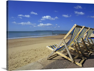 Deckchairs on the Promenade overlooking deserted beach, Dorset, England