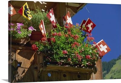 Display of flags to mark Swiss National Day, Lauterbrunnen, Bern, Swizerland