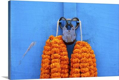 Door, padlock and flower garlands, Kolkata, West Bengal, India