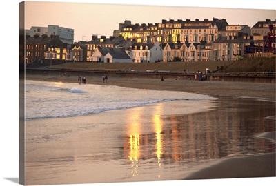 Dusk light on the beach at Portrush, County Antrim, Ulster, Northern Ireland, UK