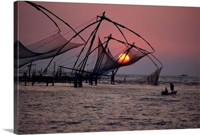 Fishing nets at sunset, Cochin, Kerala state, India, Asia