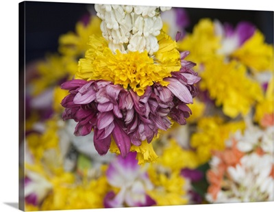 Flower garlands on a stall for temple offerings, Little India, Singapore