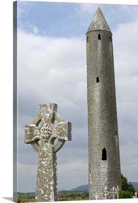 Kilmacdaugh Round Tower and Celtic style cross, Connacht, Republic of Ireland