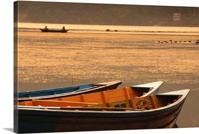 Local fishing boats on Phewa Lake at sunset, Gandak, Nepal, Asia