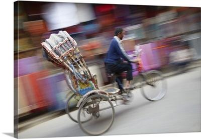 Man Riding Rickshaw, Kathmandu, Nepal