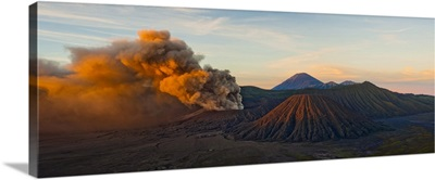 Mount Bromo, erupting at sunrise throwing up ash clouds, East Java, Indonesia