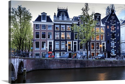 Old gabled houses line the Keizersgracht canal at dusk, Amsterdam, Netherlands