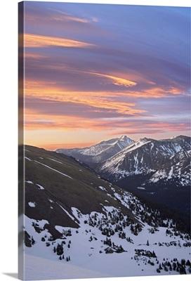 Orange clouds at dawn above Longs Peak, Rocky Mountain National Park, Colorado