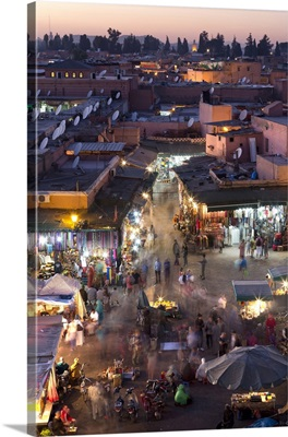 People Walking Among The Shops In The Djemaa El Fna At Sunset, Marrakech, Morocco