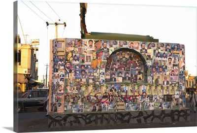 Pictures of election candidates stuck on building in midddle of street, Afghanistan