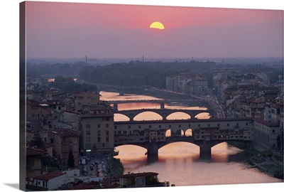 Ponte Vecchio over the River Arno at sunset in the city of Florence, Tuscany, Italy
