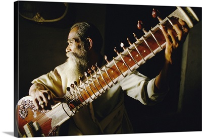 Portrait Of An Elderly Man Playing The Sitar, India