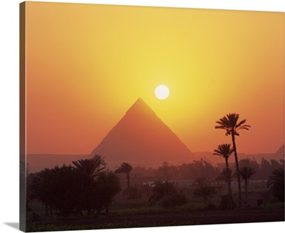 Pyramid silhouetted at sunset, Giza, Cairo, Egypt, Africa