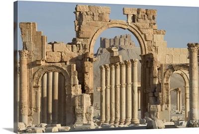 Qala'at ibn Maan castle seen through monumental arch, Palmyra, Syria
