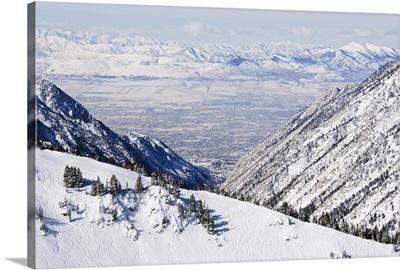 Salt Lake Valley and fresh powder tracks at Alta, Alta Ski Resort, Salt Lake City, Utah
