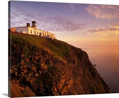 Sunset over Sumburgh Head lighthouse, Shetland Islands, Scotland, UK