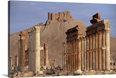 The Great Colonnade, with Arab castle on hill in background, Palmyra, Syria