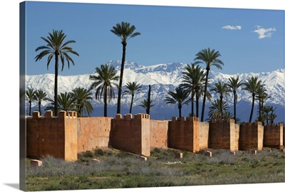 The old city walls and snow capped Atlas Mountains, Marrakech, Morocco, North Africa