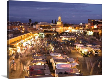 View Over Djemaa El Fna At Dusk With Foodstalls And Crowds Of People, Marrakech, Morocco
