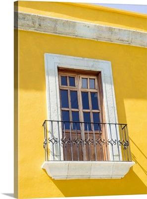 White window of yellow house, Oaxaca, Mexico
